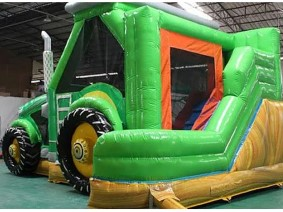 Giant Green Tractor Bounce House.
